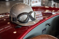 Helmet and glasses on a luxury convertible sports car. Stock Images