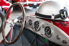 Helmet and glasses on a vintage sports car Royalty Free Stock Images