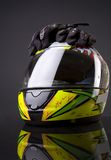 Helmet and glove Stock Photography