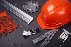 Helmet, gloves and fasteners Stock Photography