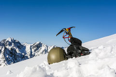 Helmet, gloves and ice axe Royalty Free Stock Photo