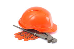 Helmet, gloves and monkey wrench Stock Images