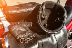 Helmet and gloves are on the seat of the motorcycle royalty free stock photo