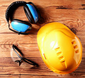 Helmet, Goggles and Ear Defenders on Table Top Stock Photos