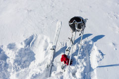 Helmet, Goggles, Poles and Skis on Snowy Hillside Stock Image