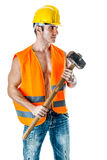 Helmet, hammer and vest. A very muscular and handsome manual worker with a sludgehammer and a yellow helmet isolated over white Royalty Free Stock Photo