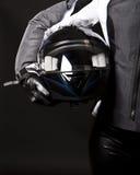 Helmet in hands. Picture of racing helmet in hands Stock Photography