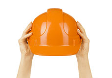 Helmet in the hands of women Stock Images