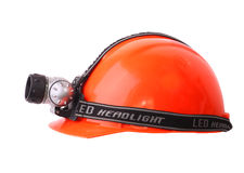 Helmet with a headlight. Red Helmet with LED headlight . Isolated object. White background Stock Images