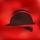 Helmet icon on blurred background Stock Images