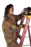 Helmet on ladder Stock Photo