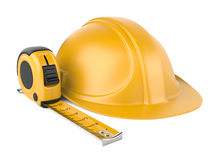 Helmet and measuring tape Royalty Free Stock Photo