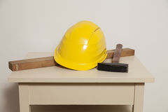 Helmet, mechanic's level and hammer Royalty Free Stock Photography
