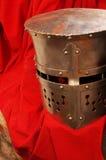 Helmet medieval armor red drapery Stock Images