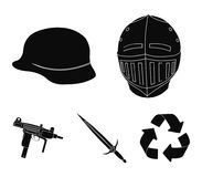A helmet of a medieval knight, a soldier`s helmet, a sword, an automaton uzi. Weapons set collection icons in black. Style vector symbol stock illustration Stock Photos