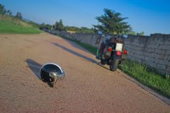 Helmet and motorcycle Stock Image
