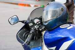 Helmet on a motorcycle. In the rain Stock Photo