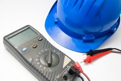 Helmet and multimeter isolated. Isolated blue helmet and multimeter for workers Royalty Free Stock Photography