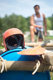 Helmet and oar on inflatable raft Royalty Free Stock Photos