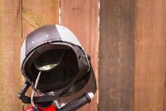 Helmet. Retro motorcycle helmet under wooden panels Stock Photography