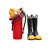 Helmet shoes and extinguisher Stock Photos