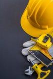 Helmet square ruler tapeline screwdriver wrench Stock Photos