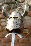 Helmet and sword Stock Photos