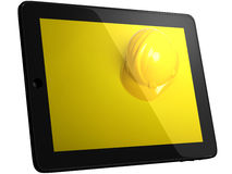 Helmet On Tablet Computer Screen Royalty Free Stock Photography