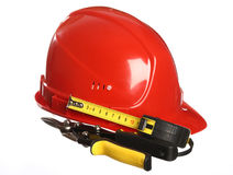 Helmet, tape line and snips Royalty Free Stock Photo