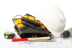 Helmet with tool belt Stock Image