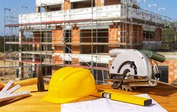 Helmet and tools on a construction site Stock Photography