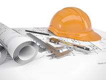 Helmet and tools for construction drawings Royalty Free Stock Image
