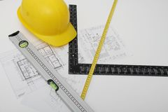 Helmet and tools for construction drawings and buildings Stock Images
