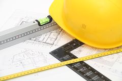 Helmet and tools for construction drawings and buildings Royalty Free Stock Photos