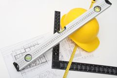Helmet and tools for construction drawings and buildings Royalty Free Stock Image