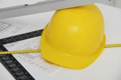 Helmet and tools for construction drawings and buildings Stock Photography