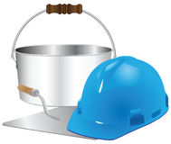 Helmet and trowel with bucket of cement Royalty Free Stock Photos