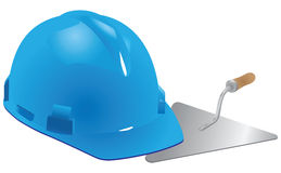 Helmet and trowel mason Stock Photos