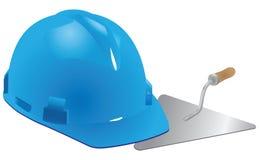 Helmet and trowel mason Stock Photos
