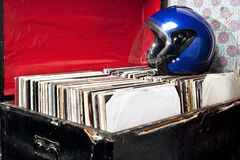Helmet on a trunk with vinyl records Stock Image
