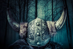Helmet, Viking warrior, male dressed in Barbarian style with swo Royalty Free Stock Photos