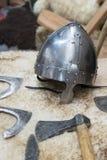 Helmet vikings. Helmet and ax of vikings royalty free stock image