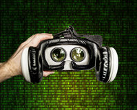 Helmet of virtual reality against the background of  matrix figu Stock Image