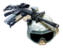 A helmet and weapon Royalty Free Stock Image