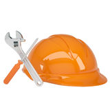 Helmet, wrench and a screwdriver Royalty Free Stock Photo