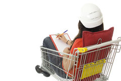 Helmeted woman in shopping cart with clipboard Stock Photos