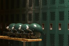 The helmets. Football helmet in locker room Stock Photography