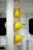 Helmets. Yellow helmets on the ship royalty free stock image