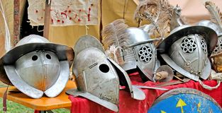 Helmets of ancient Roman origin and medieval helmets of brave kn Royalty Free Stock Images