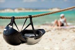 Helmets on the beach. Stock Photography